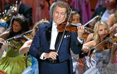 MUNICH, GERMANY - NOVEMBER 23:  Andre Rieu during the tv show 'Heiligabend mit Carmen Nebel' on November 23, 2016 in Munich, Germany. The show will air on December 24, 2016.  (Photo by Hannes Magerstaedt/Getty Images)